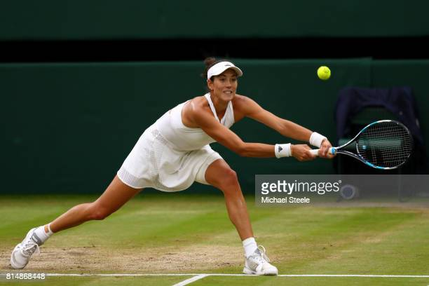 Garbine Muguruza of Spain plays a backhand during the Ladies Singles final against Venus Williams of The United States on day twelve of the Wimbledon...