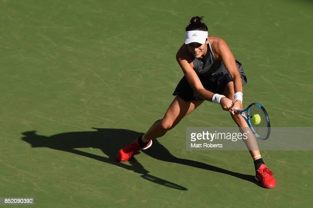 Garbine Muguruza of Spain plays a backhand in her semi final match against Caroline Wozniacki of Denmark during day six of the Toray Pan Pacific Open...