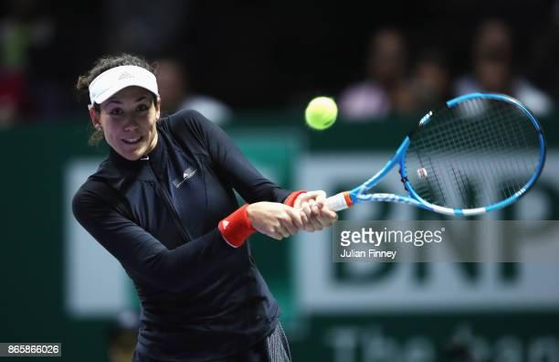 Garbine Muguruza of Spain plays a backhand in her singles match against Karolina Pliskova of Czech Republic during day 3 of the BNP Paribas WTA...