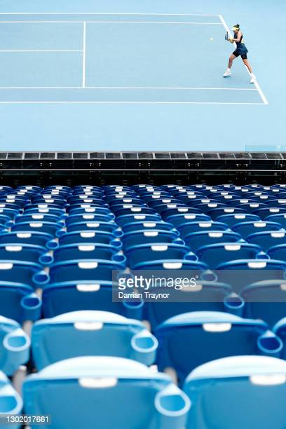 Garbine Muguruza of Spain plays a backhand in her Women's Singles fourth round match against Naomi Osaka of Japan during day seven of the 2021...
