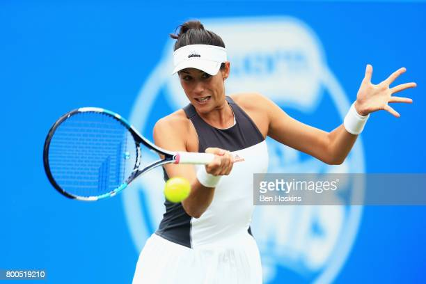 Garbine Muguruza of Spain plays a backhand shot during her semi final match against Ashleigh Barty day six of the Aegon Classic Birmingham at...