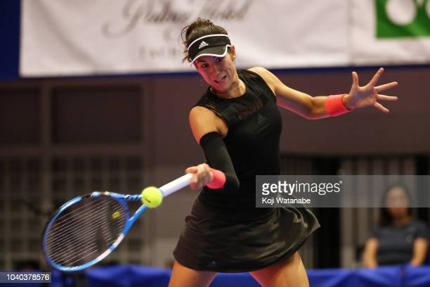Garbine Muguruza of Spain plays a forehand against Alison Riske of the United States in the Singles second round on day three of the Toray Pan...