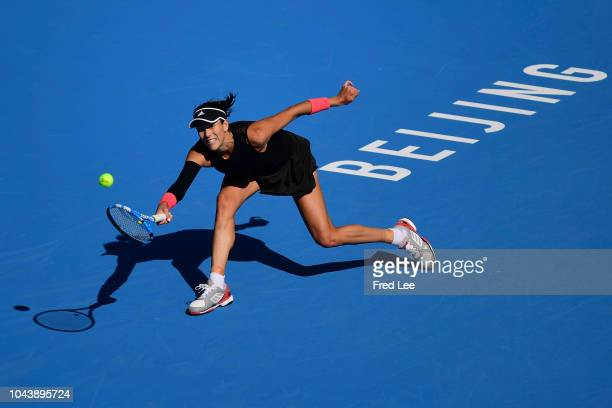 Garbine Muguruza of Spain plays a forehand against Ekaterina Makarova of Russia during their Women's Singles 1nd Round match of the 2018 China Open...