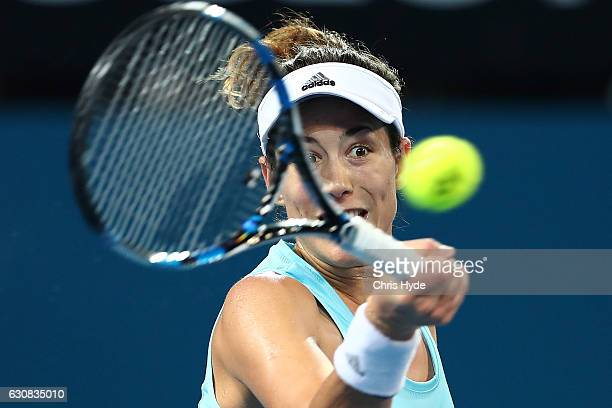 Garbine Muguruza of Spain plays a forehand during her match against Daria Kasatkina of Russia on day three of the 2017 Brisbane International at Pat...
