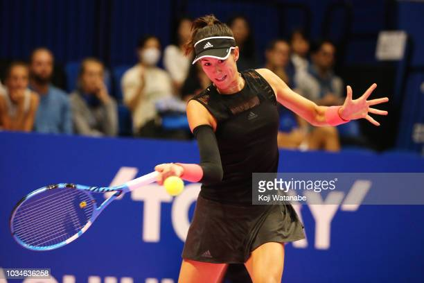 Garbine Muguruza of Spain plays a forehand during her singles first round match against Belinda Bencic of Switzerland on day one of the Toray Pan...