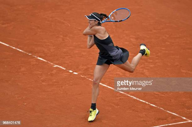 Garbine Muguruza of Spain plays a forehand during her women's singles quaterfinal match against Maria Sharapova of Russia on day 11 of the 2018...