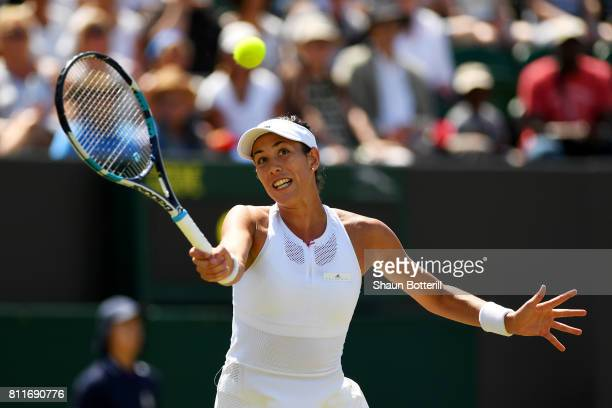 Garbine Muguruza of Spain plays a forehand during the Ladies Singles fourth round match against Angelique Kerber of Germany on day seven of the...