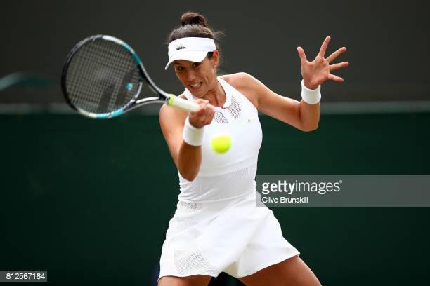 Garbine Muguruza of Spain plays a forehand during the Ladies Singles quarter final match against Svetlana Kuznetsova of Russia on day eight of the...