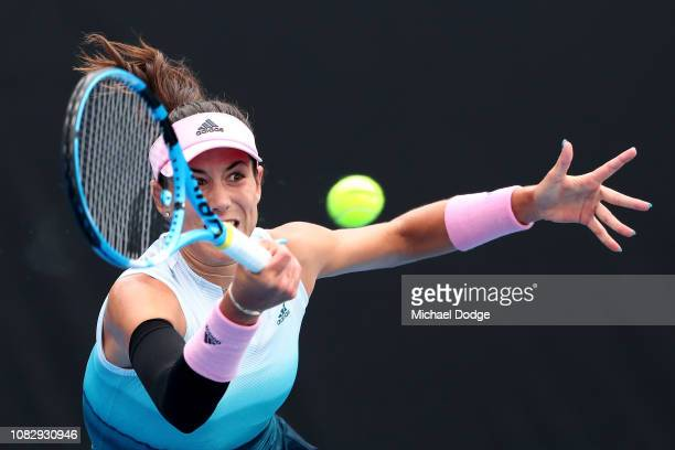 Garbine Muguruza of Spain plays a forehand in her first round match against Saisai Zheng of China during day two of the 2019 Australian Open at...