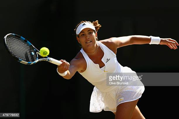 Garbine Muguruza of Spain plays a forehand in her Ladies Singles Quarter Final match against Timea Bacsinszky of Switzerland during day eight of the...