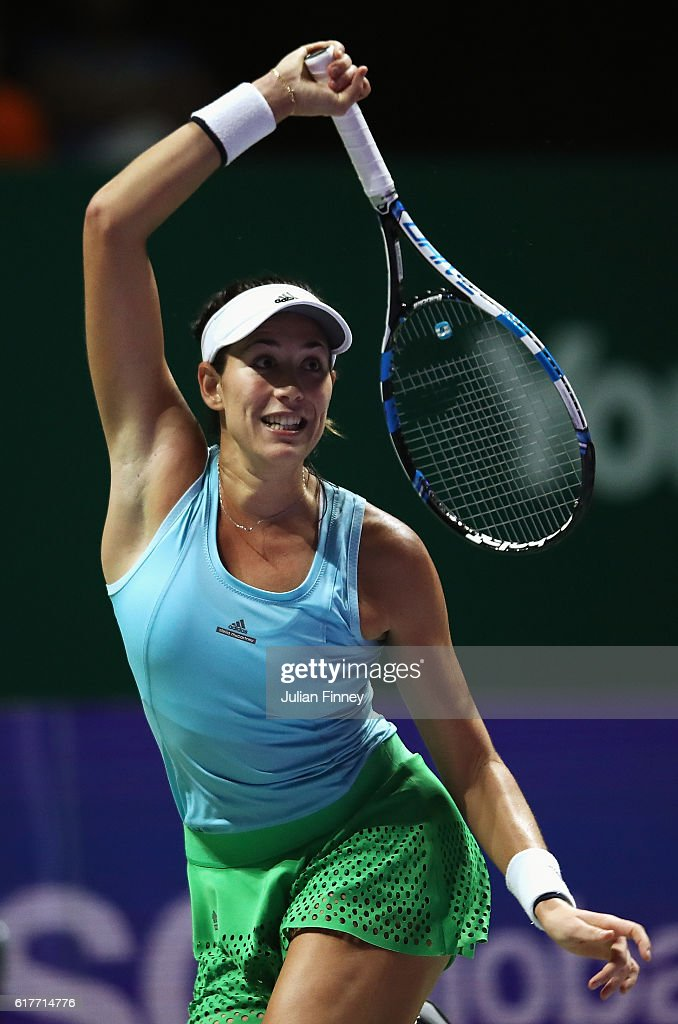 Garbine Muguruza of Spain plays a forehand in her singles match against Karolina Pliskova of Czech Republic during the BNP Paribas WTA Finals Singapore at Singapore Sports Hub on October 24, 2016 in Singapore.