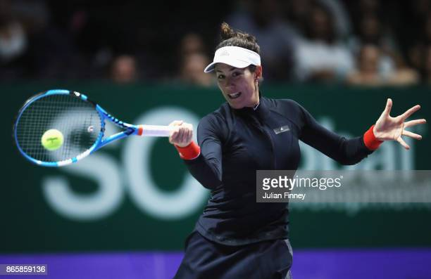 Garbine Muguruza of Spain plays a forehand in her singles match against Karolina Pliskova of Czech Republic during day 3 of the BNP Paribas WTA...