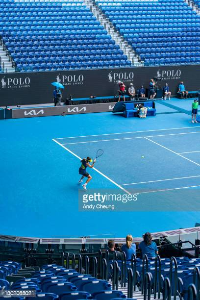 Garbine Muguruza of Spain plays a forehand in her Women's Singles fourth round match against Naomi Osaka of Japan during day seven of the 2021...