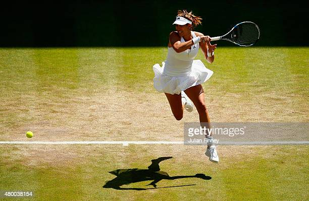 Garbine Muguruza of Spain plays a forehand in the Ladies Singles Semi Final match against Agnieszka Radwanska of Poland during day ten of the...