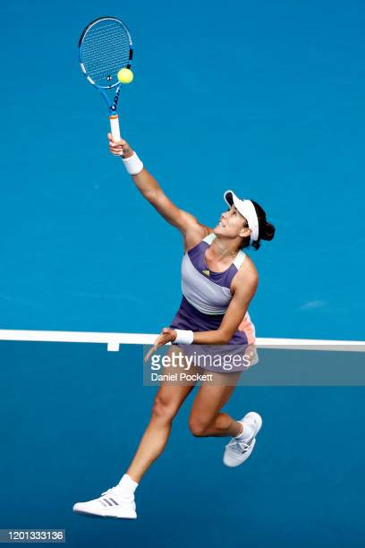 Garbine Muguruza of Spain plays an overhead shot during her Women's Singles second round match against Ajla Tomljanovic of Australia on day four of...