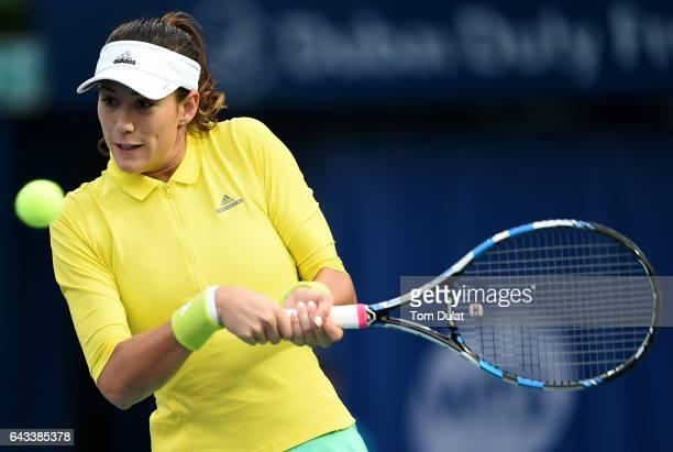 Garbine Muguruza of Spain plays backhand against Kateryna Bondarenko of Ukraine during day three of the WTA Dubai Duty Free Tennis Championship at...