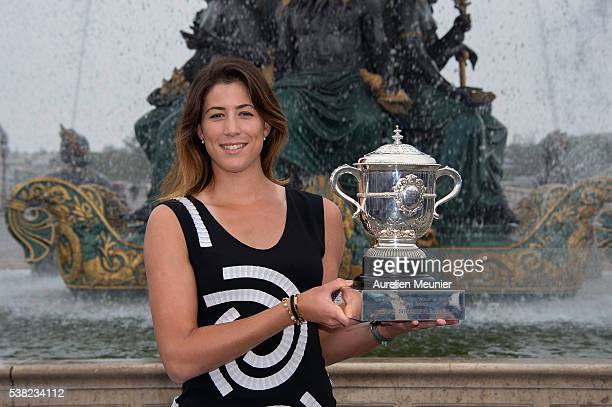 Garbine Muguruza of Spain poses with La Coupe Suzanne Lenglen after winning the women's final at the French Open at Place de la Concorde on June 5...