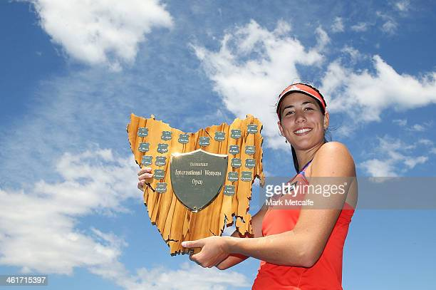 Garbine Muguruza of Spain poses with the winners trophy after victory in her singles final match against Klara Zakopalova of the Czech Republic...