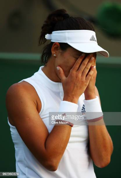 Garbine Muguruza of Spain reacts against Alison Van Uytvanck of Belgium during their Ladies' Singles second round match on day four of the Wimbledon...