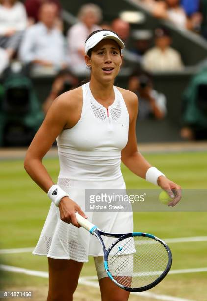 Garbine Muguruza of Spain reacts as she celebrates championship point and victory after the Ladies Singles final against Venus Williams of The United...