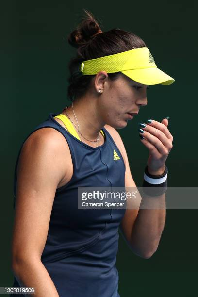 Garbine Muguruza of Spain reacts in her Women's Singles fourth round match against Naomi Osaka of Japan during day seven of the 2021 Australian Open...
