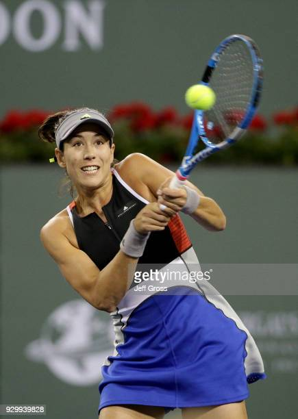 Garbine Muguruza of Spain returns a backhand to Sachia Vickery during the BNP Paribas Open at the Indian Wells Tennis Garden on March 9 2018 in...