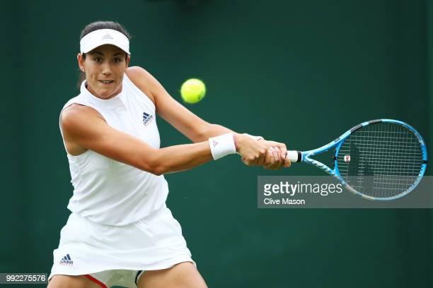 Garbine Muguruza of Spain returns a shot against Alison Van Uytvanck of Belgium during their Ladies' Singles second round match on day four of the...