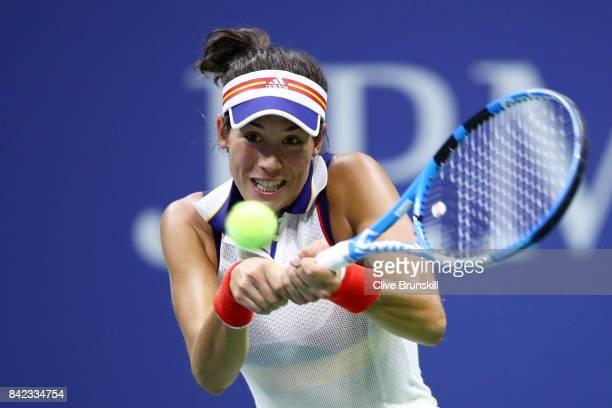 Garbine Muguruza of Spain returns a shot during her women's singles fourth round match against Petra Kvitova of Czech Republic on Day Seven of the...