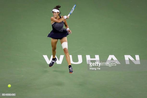 Garbine Muguruza of Spain returns a shot during the match against Magda Linette of Poland on Day 4 of 2017 Dongfeng Motor Wuhan Open at Optics Valley...