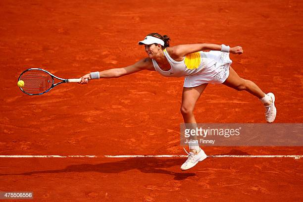 Garbine Muguruza of Spain returns a shot in her Women's Singles match against Flavia Pennetta of Italy on day nine of the 2015 French Open at Roland...