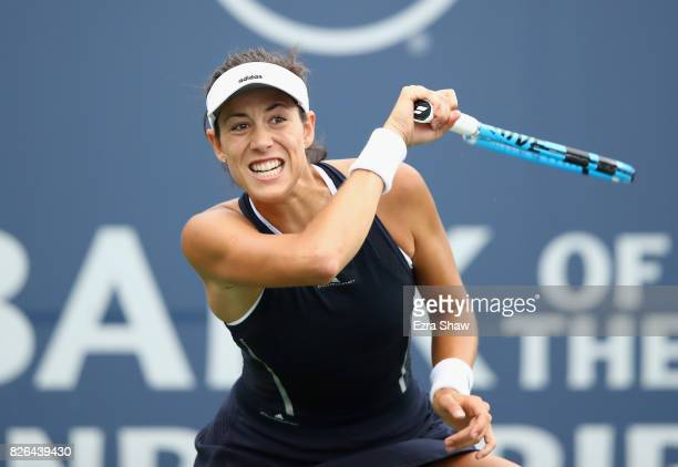 Garbine Muguruza of Spain returns a shot to Ana Konjuh of Croatia during their quarterfinal match on Day 5 of the Bank of the West Classic at...