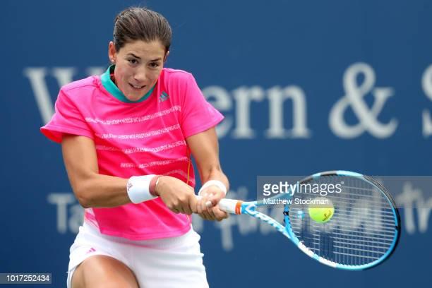 Garbine Muguruza of Spain returns a shot to Lesia Tsurenko of Ukraine during the Western Southern Open at Lindner Family Tennis Center on August 15...