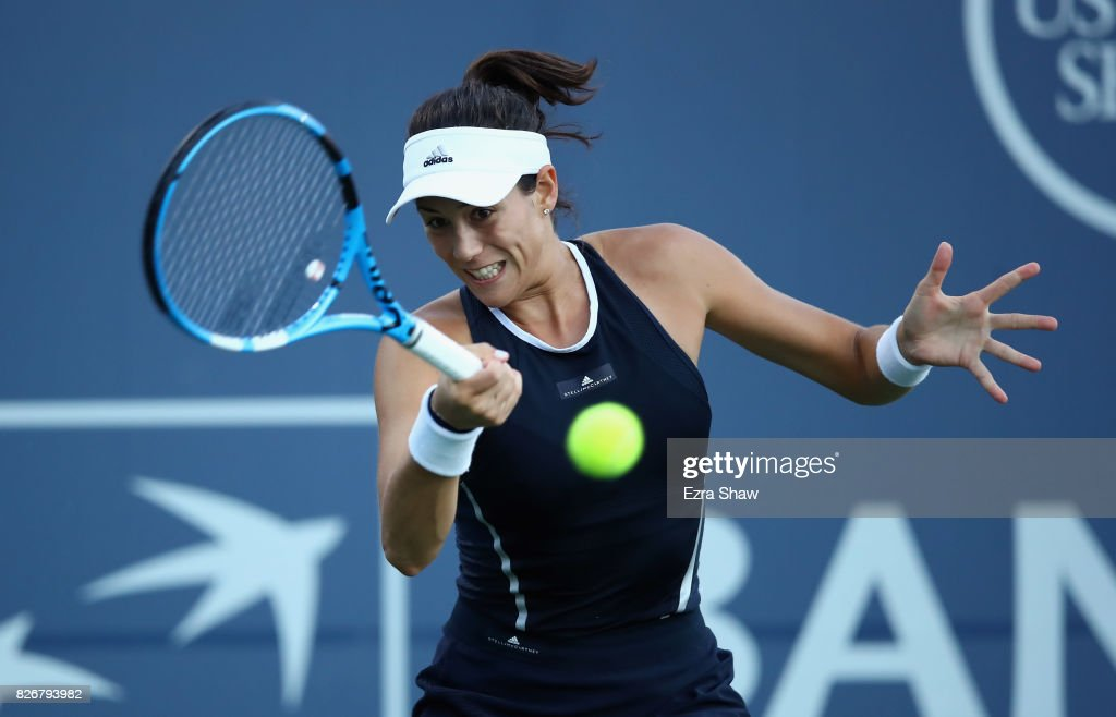 Garbine Muguruza of Spain returns a shot to Madison Keys of the United States during their semifinal match on Day 6 of the Bank of the West Classic at Stanford University Taube Family Tennis Stadium on August 5, 2017 in Stanford, California.