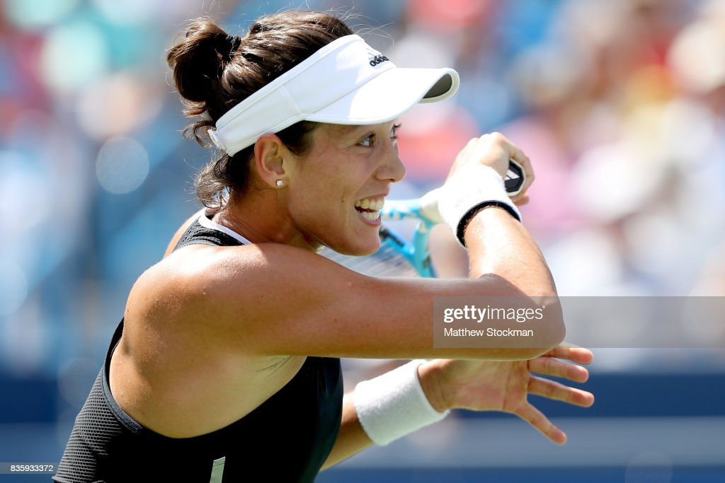 Garbine Muguruza of Spain returns a shot to Simona Halep of Romania during the women's final on day 9 of the Western & Southern Open at the Lindner Family Tennis Center on August 20, 2017 in Mason, Ohio.