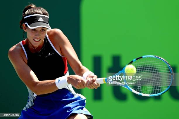 Garbine Muguruza of Spain returns a shot to Sloane Stephens during the Miami Open Presented by Itau at Crandon Park Tennis Center on March 26 2018 in...