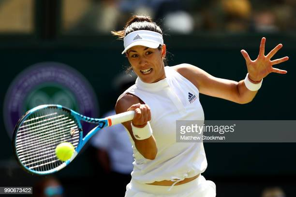 Garbine Muguruza of Spain returns against Naomi Broady of Great Britain during their Ladies' Singles first round match on day two of the Wimbledon...
