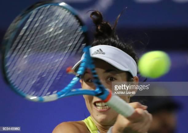 Garbine Muguruza of Spain returns the ball to Daria Kasatkina of Russia during their semifinal match at the WTA Dubai Duty Free Tennis Championship...