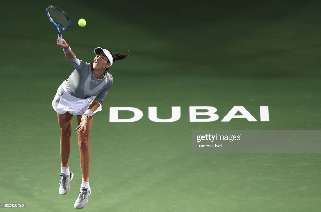 Garbine Muguruza of Spain serves against Catherine Bellis of USA during day three of the WTA Dubai Duty Free Tennis Championship at the Dubai Tennis Stadiumon February 21, 2018 in Dubai, United Arab Emirates.