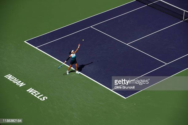 Garbine Muguruza of Spain serves against Kiki Bertens of the Netherlands during their women's singles fourth round match on day nine of the BNP...