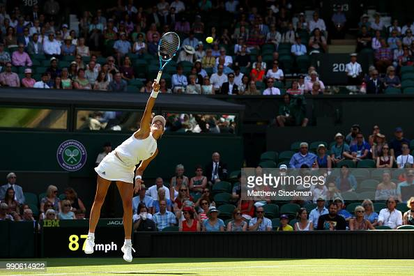 Garbine Muguruza of Spain serves against Naomi Broady of Great Britain during their Ladies' Singles first round match on day two of the Wimbledon...