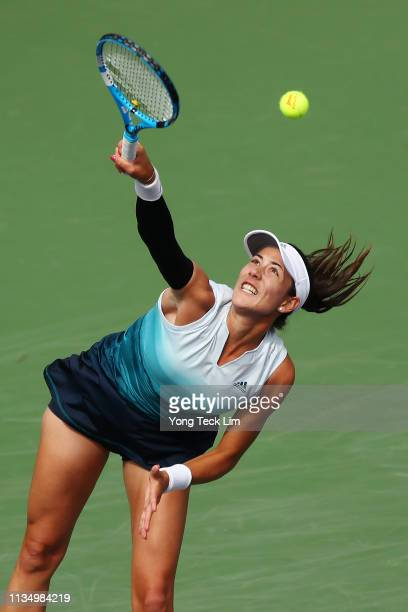 Garbine Muguruza of Spain serves against Serena Williams of the United States during their women's singles third round match on Day 7 of the BNP...