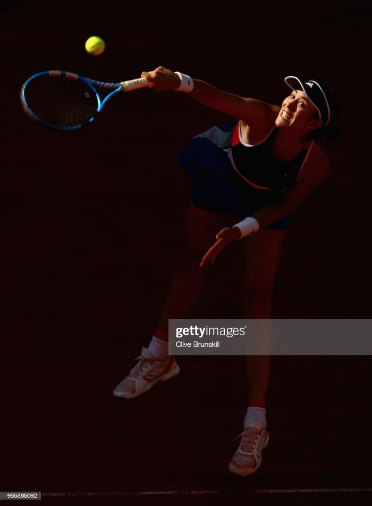 Garbine Muguruza of Spain serves against Shuai Peng of China in their first round match during day two of the Mutua Madrid Open tennis tournament at the Caja Magica on May 6, 2018 in Madrid, Spain.