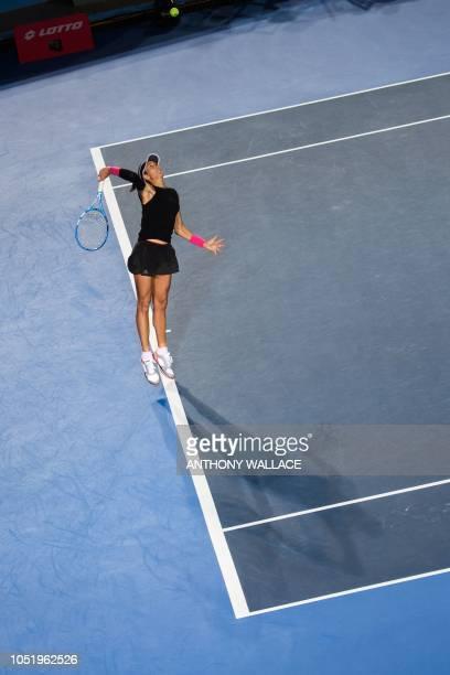 Garbine Muguruza of Spain serves during her quarterfinal women's singles match against Luksika KumKhum of Thailand at the Hong Kong Open tennis...