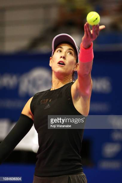 Garbine Muguruza of Spain serves during her singles first round match against Belinda Bencic of Switzerland on day one of the Toray Pan Pacific Open...