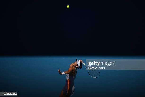 Garbine Muguruza of Spain serves during her Women's Singles Quarterfinal match against Anastasia Pavlyuchenkova of Russia on day ten of the 2020...