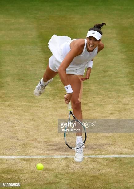 Garbine Muguruza of Spain serves during the Ladies Singles quarter final match against Svetlana Kuznetsova of Russia on day eight of the Wimbledon...