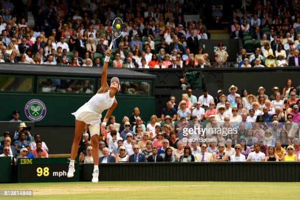 Garbine Muguruza of Spain serves during the Ladies Singles semi final match against Magdalena Rybarikova of Slovakia on day ten of the Wimbledon Lawn...