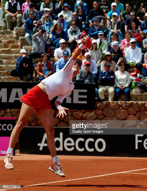 Garbine Muguruza of Spain serves during the match against Veronica Cepede of Paraguay during day two of the Fed Cup by BNP Paribas World Cup Group II...