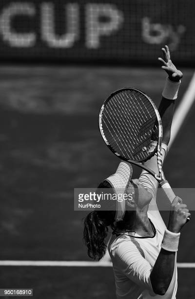 the image has been converted to black and white Garbine Muguruza of Spain serves in her match against Veronica Cepede Royg of Paraguay during day two...
