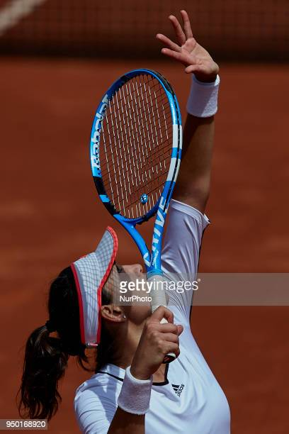 Garbine Muguruza of Spain serves in her match against Veronica Cepede Royg of Paraguay during day two of the Fedcup World Group II Playoffs match...